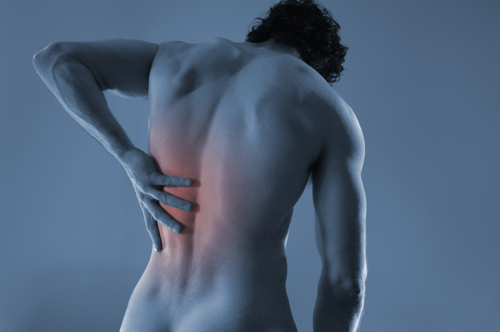 man suffering from excruciating back pain